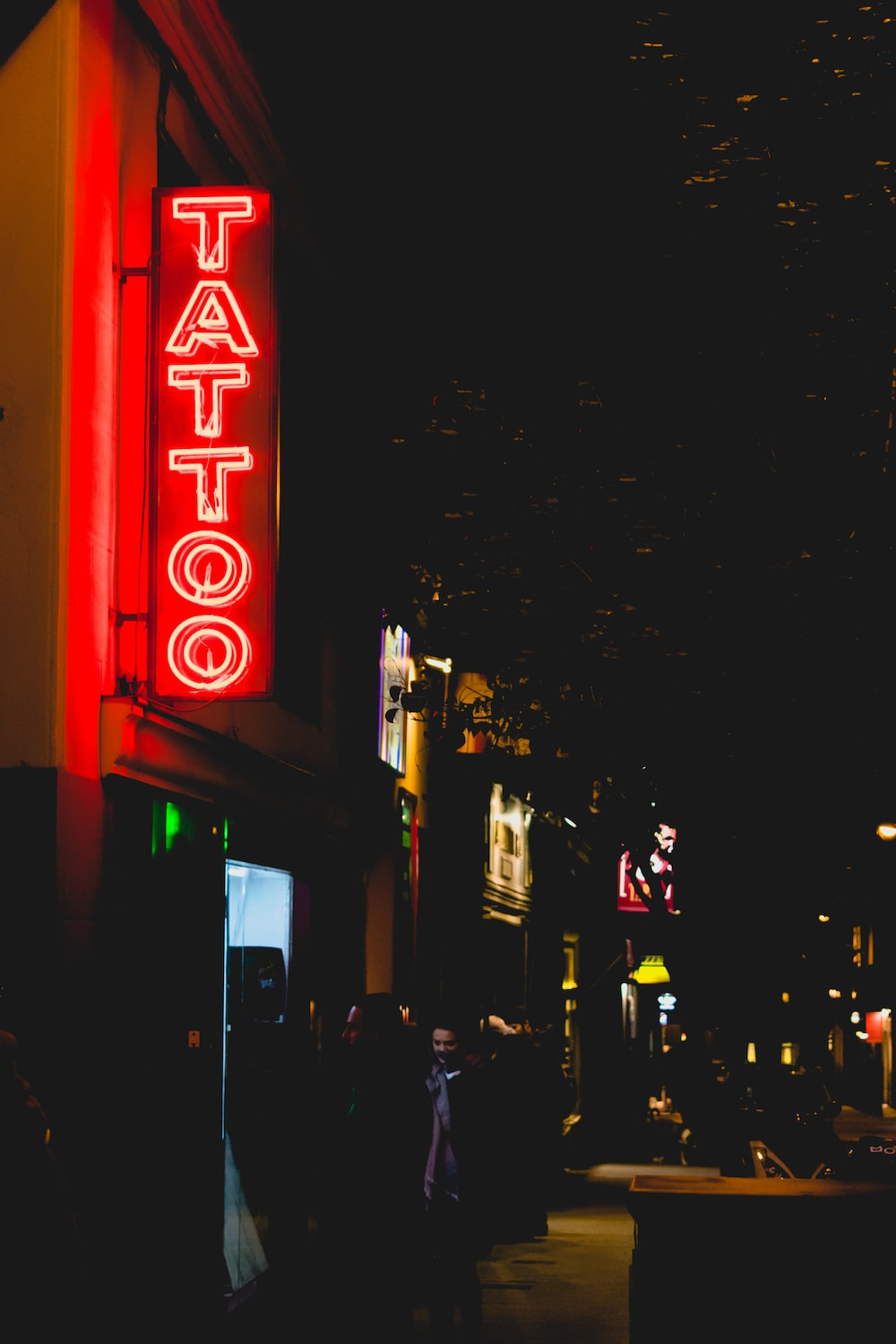 red and white tattoo neon signage