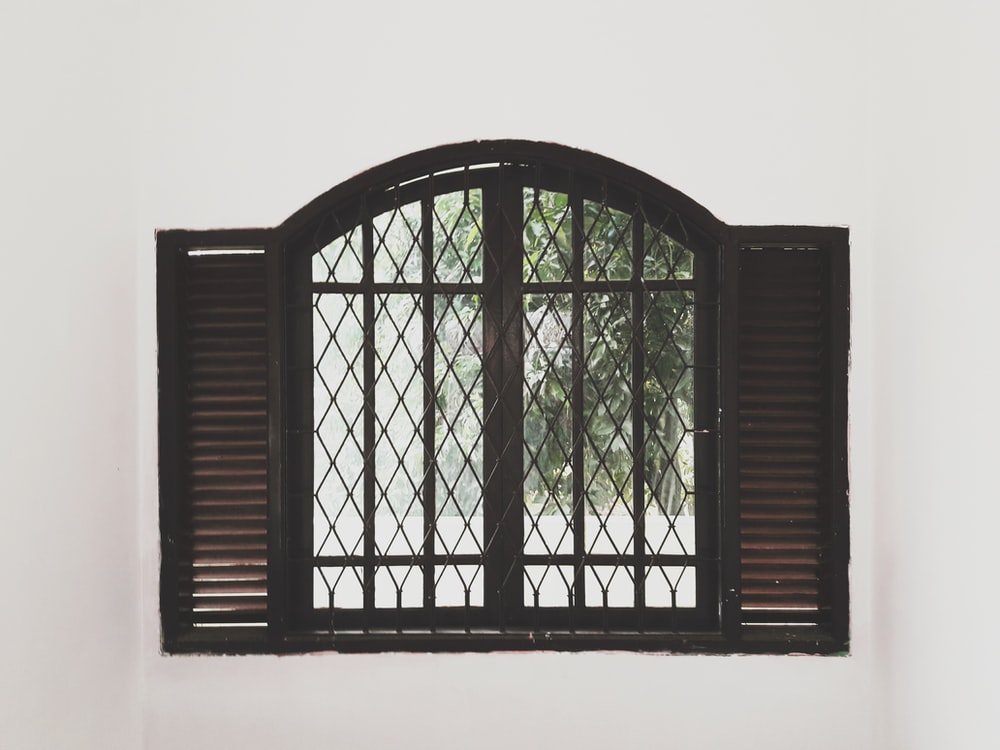 closing black wooden window