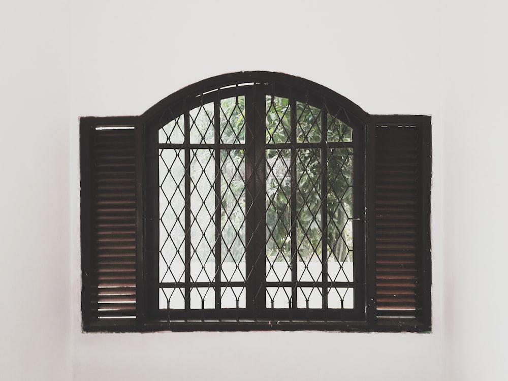 closing black wooden window