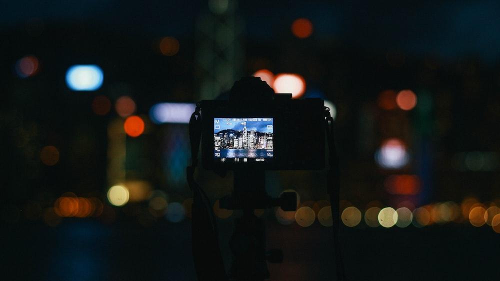 bokeh photography of digital camera