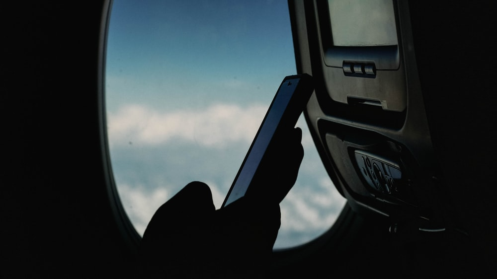 person using smartphone at the airliner