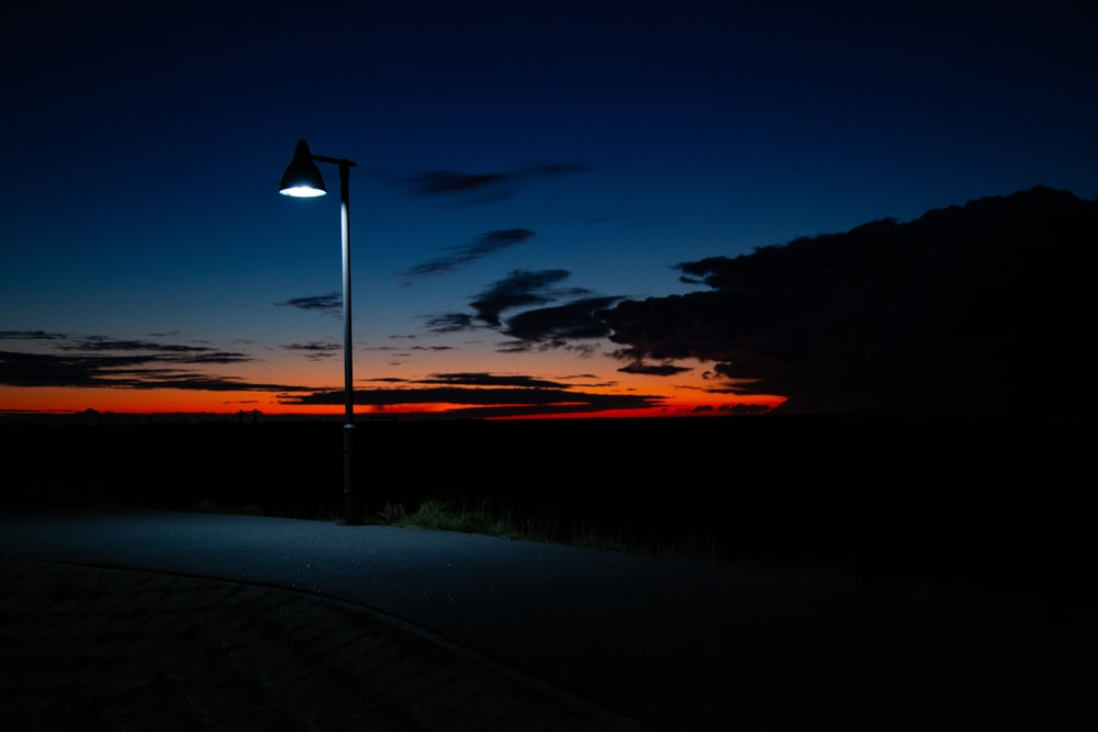 lighted outdoor lamp during nightime