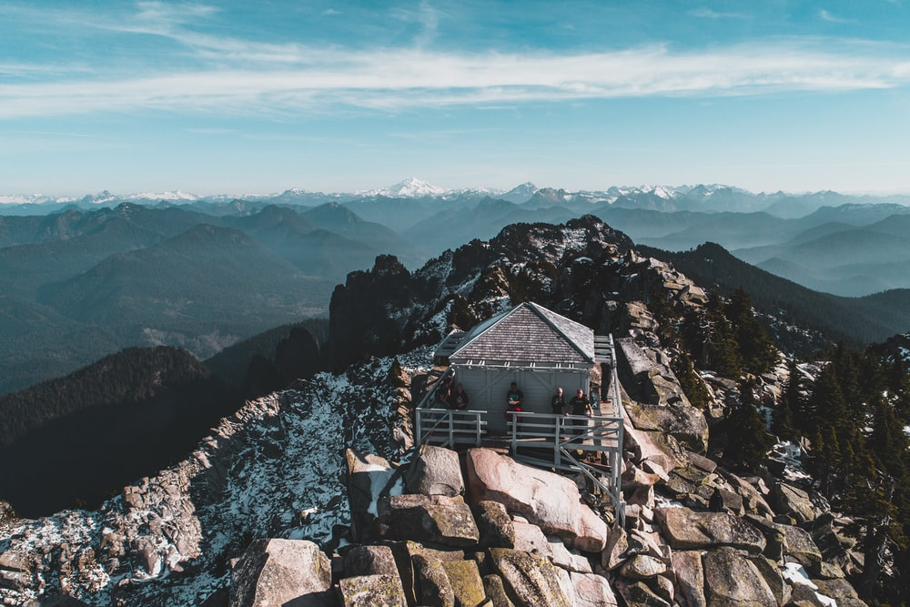 bird's-eye-photography of gray house on top of mountain
