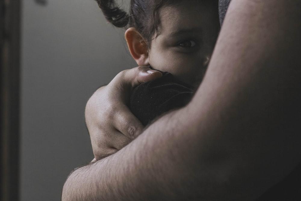 toddler hugs person