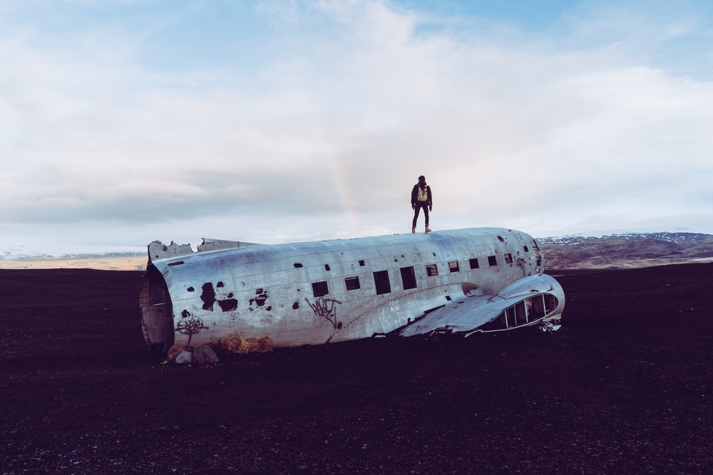 person standing on destroyed airliner