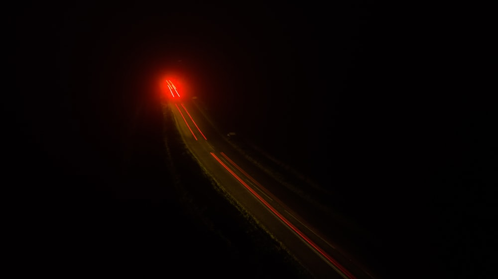 time lapse and light streaks of vehicle on road