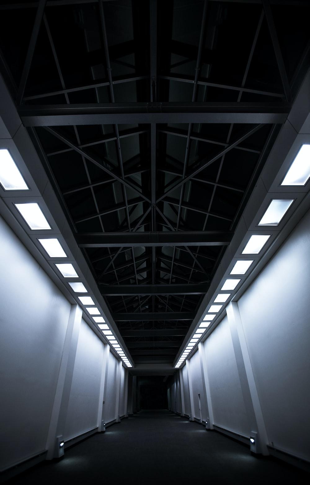 white and gray concrete hallway
