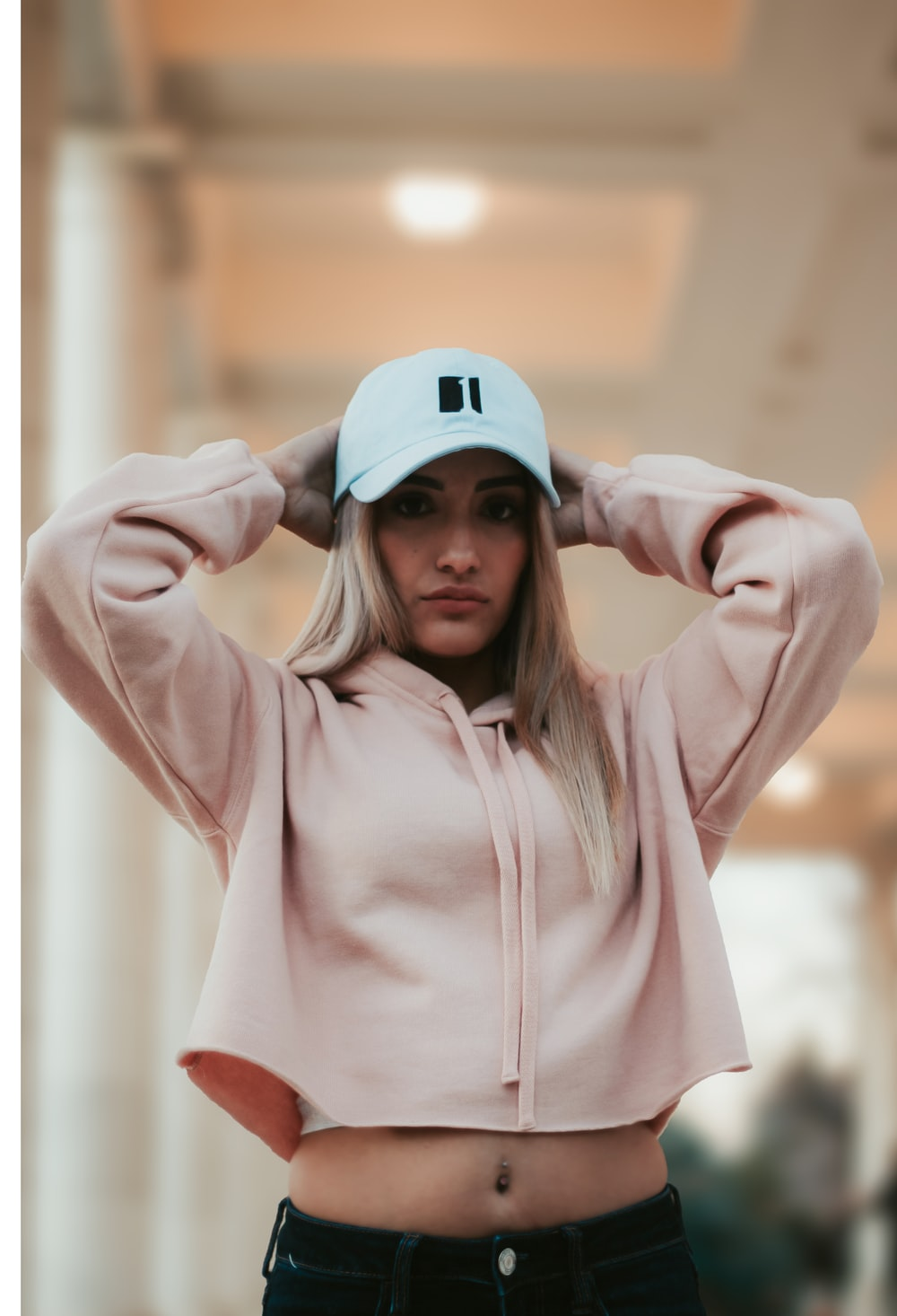 woman wearing pink hoodie and cap