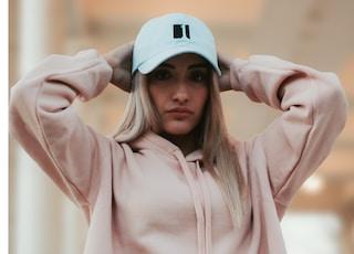 woman wearing pink hoodie and cap