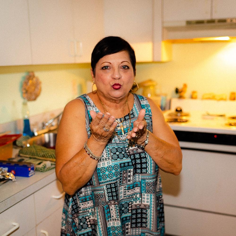 woman standing beside kitchen sink