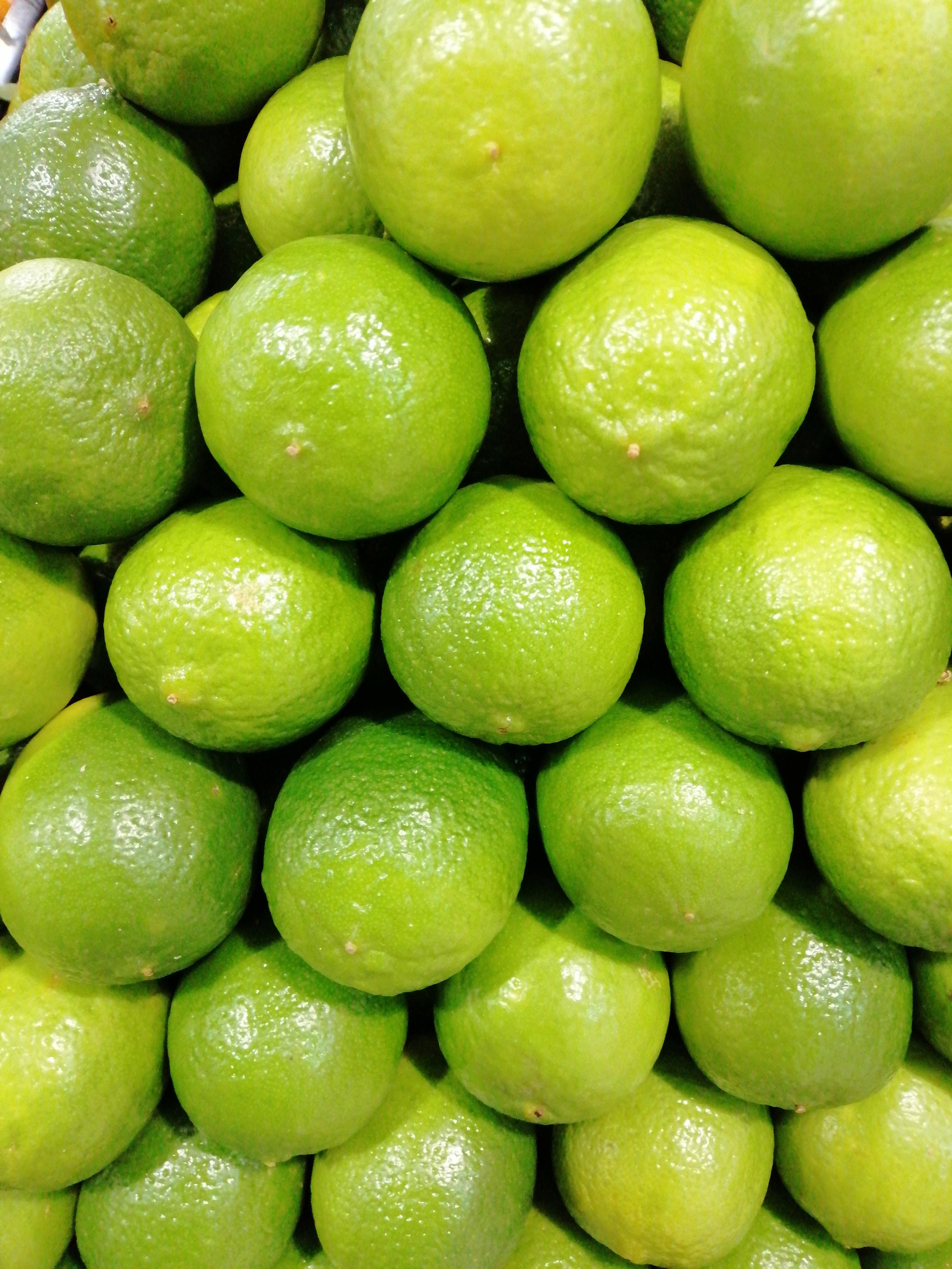 green and yellow mango fruits