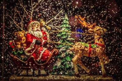 santa claus riding sleigh holding rope of reindeer figurine sleigh teams background