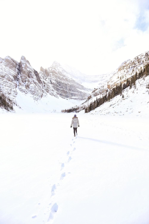 person walking on snowfield