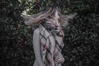 woman wearing brown scarf