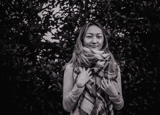 grayscale photography of woman wearing scarf