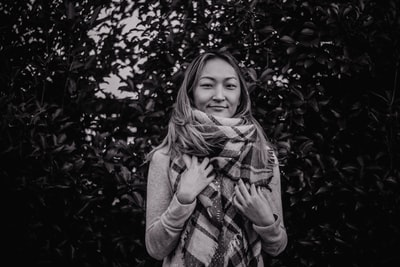 grayscale photography of woman wearing scarf scarf zoom background