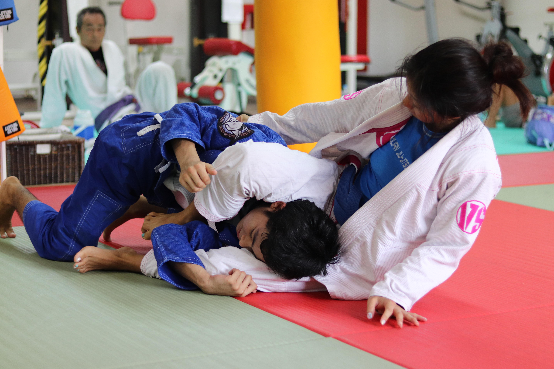 girl and boy doing Brazilian jiu-jitsu