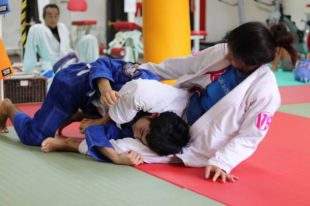 girl and boy doing Brazilian jiu-jitsu