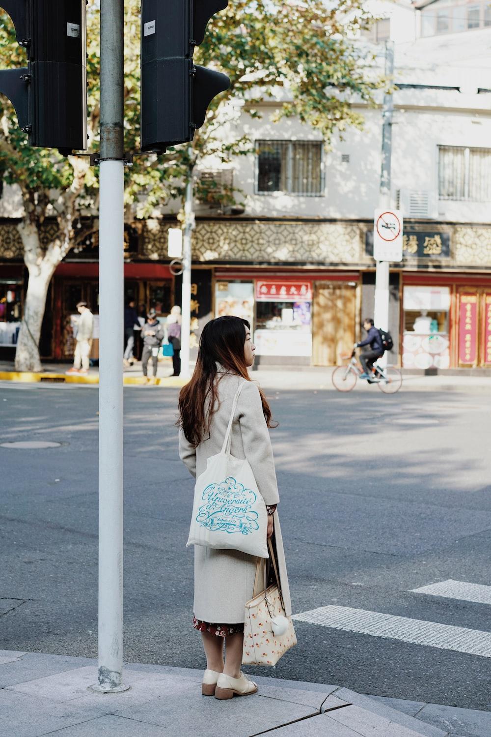 woman about to cross on crosswalk