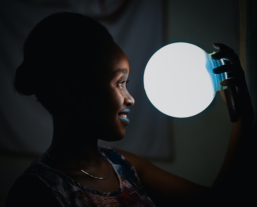 woman holding bulb