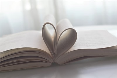 book page formed as heart love zoom background