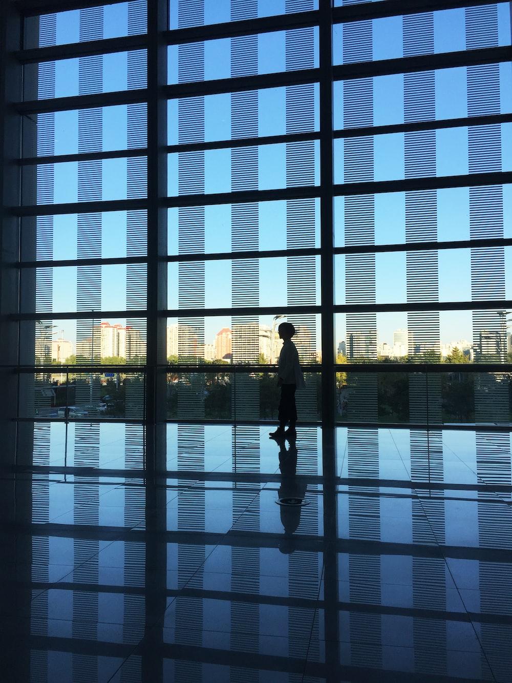 woman walking on building