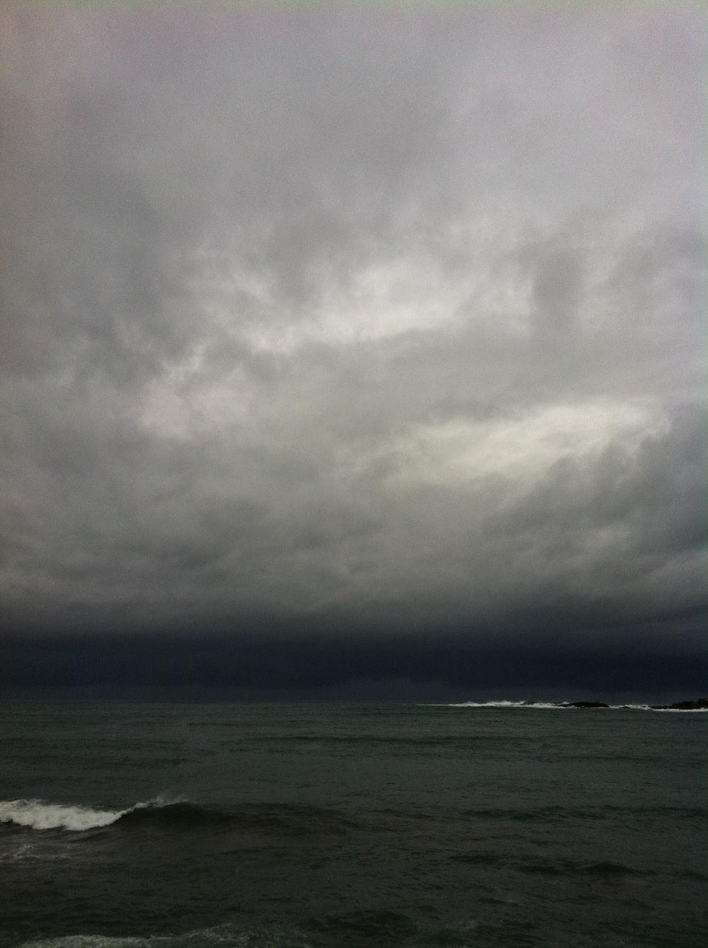 ocean waves under nimbus clouds