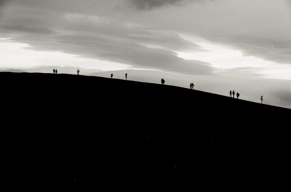 silhoette of person walking mountain