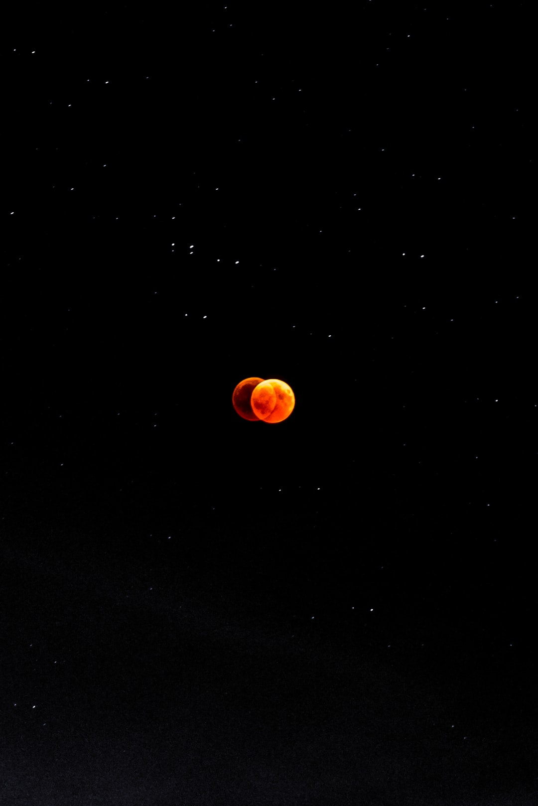 """The Longest 'Blood Moon' Eclipse of the Century.  A lunar eclipse occurs when the Earth passes between the sun and the moon. Unlike with a solar eclipse, when the moon passes between the Earth and sun, blocking the sun's light, the moon is not """"turned dark"""" during an eclipse, but instead appears to turn red.  Because there is light scattered through the atmosphere of the Earth, some of the sun's light gets bounced around the edge of the Earth to hit the moon.  Blue and violet wavelengths are scattered more than red and orange ones, this making the moon appear red."""