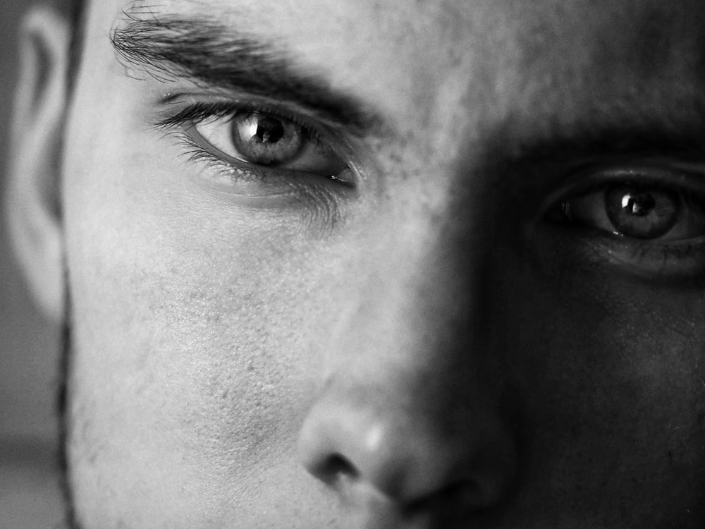 grayscale photo of person's nose and person's eye
