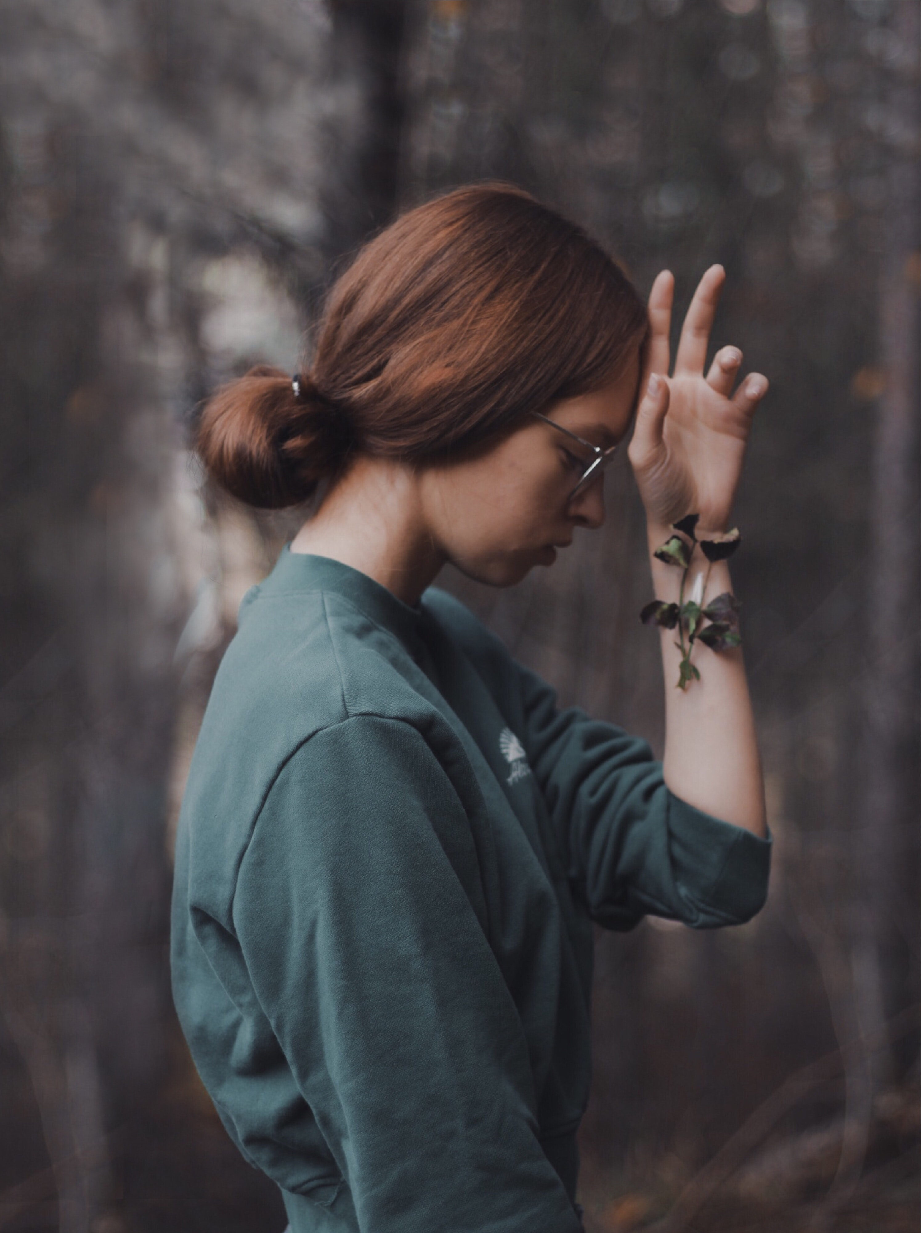 selective focus photography of woman wearing grey crew-neck 3/4-sleeved top in front of forest