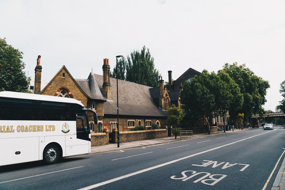 bus at the road near architectural building