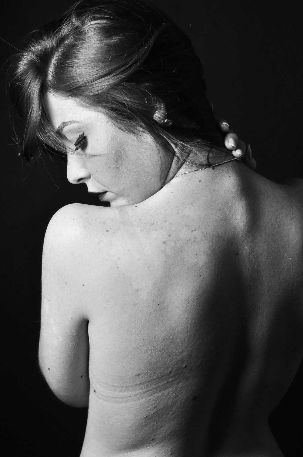 grayscale photo of topless woman