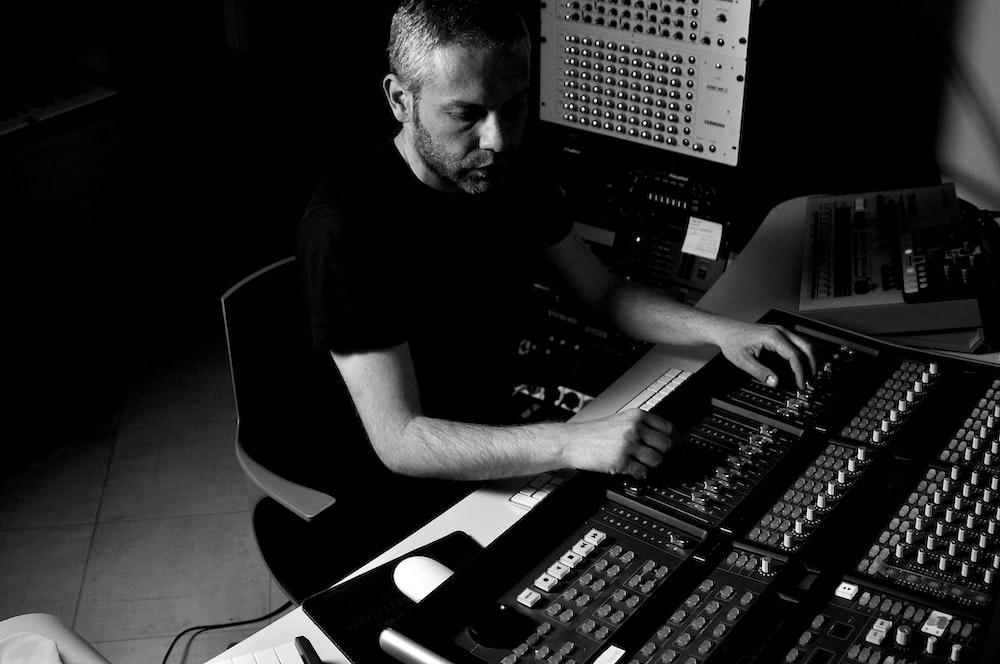 man using studio amplifier