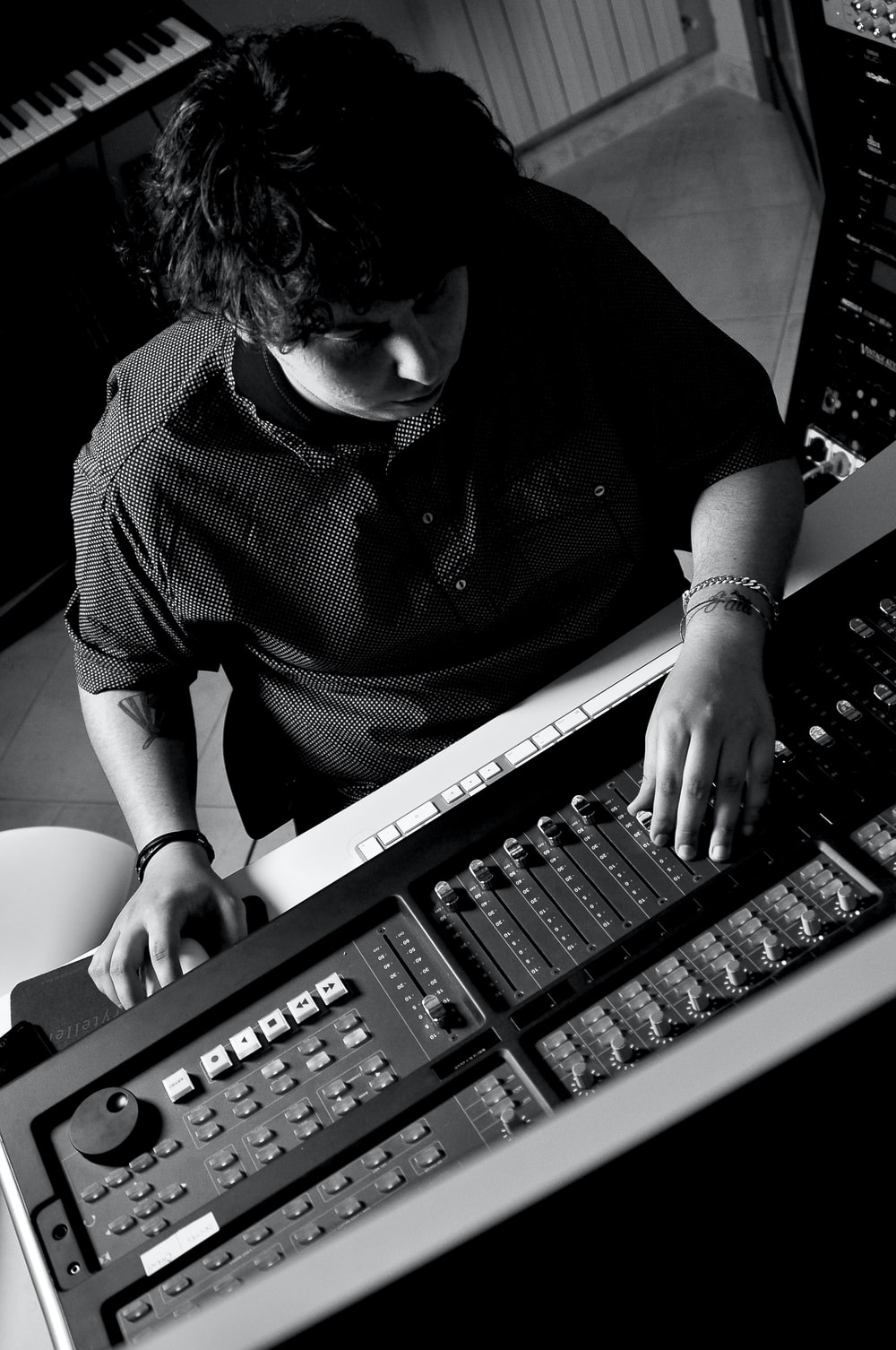 person playing audio mixer