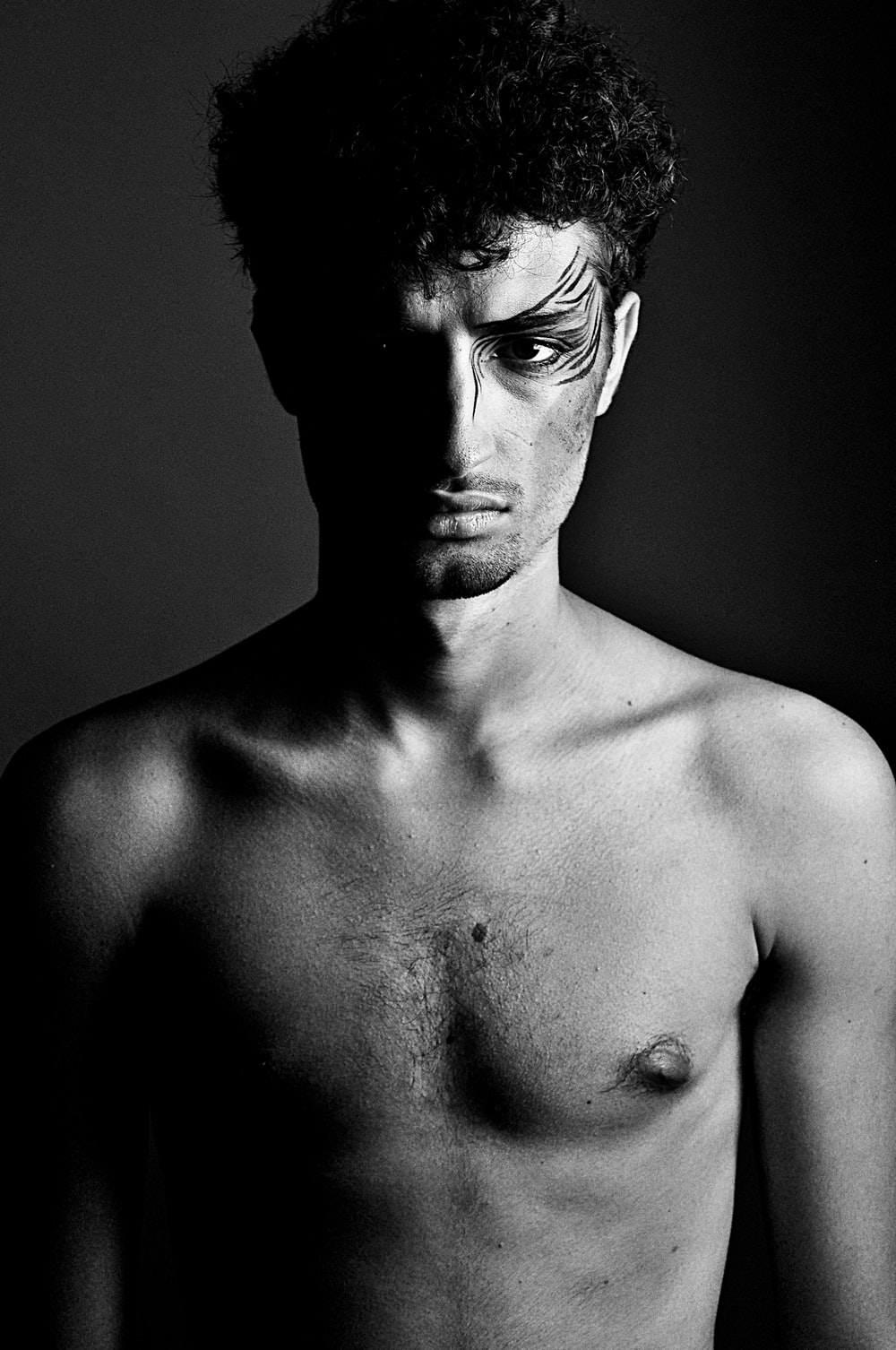 grayscale photography of topless man