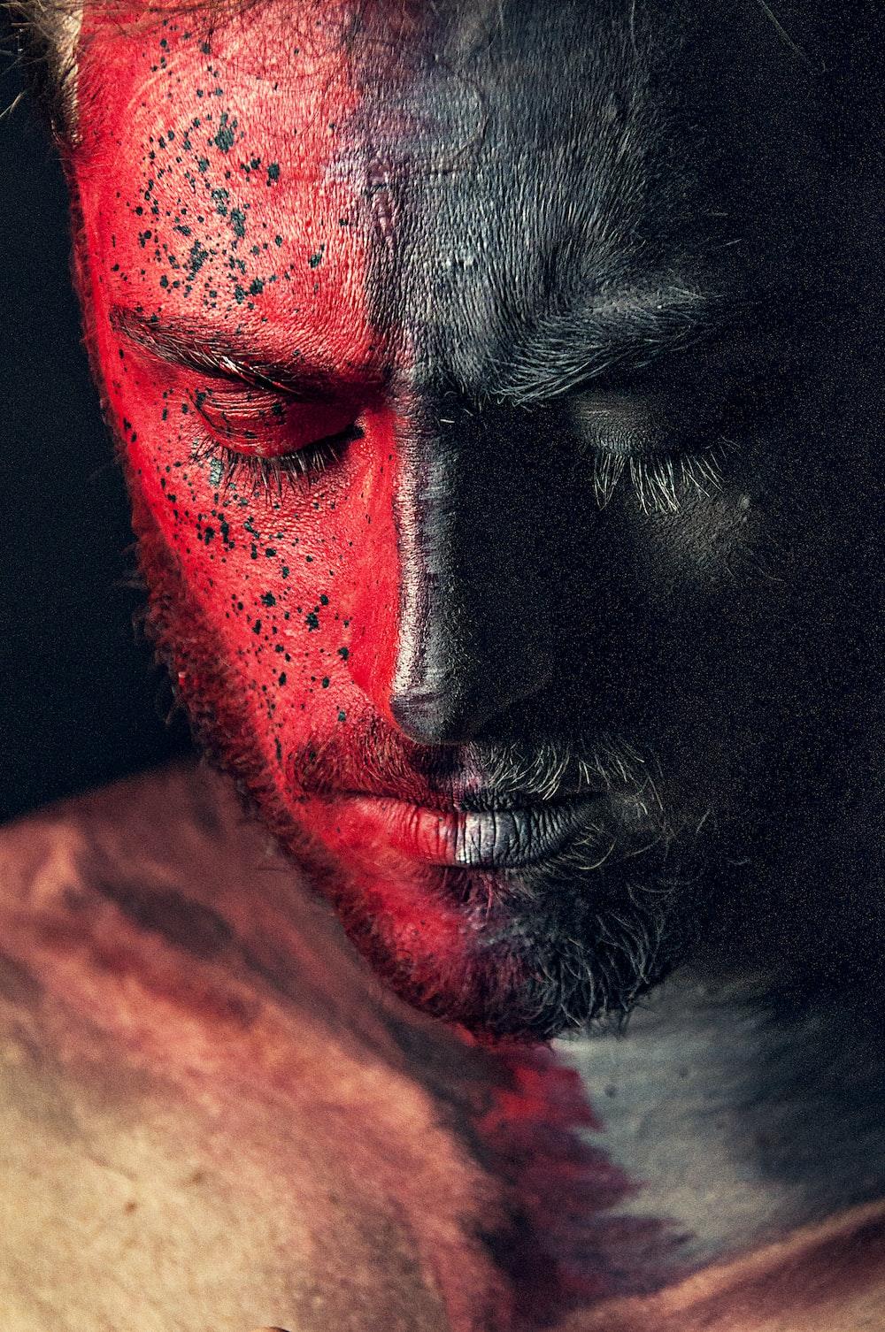 man portrait red and black paint