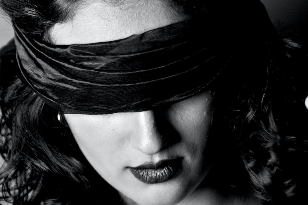 closeup photo of woman with blindfold