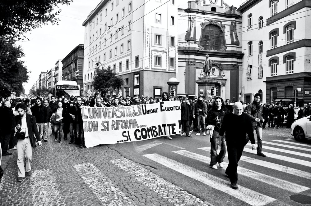 people marching on street