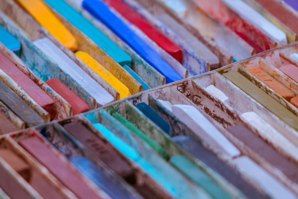 selective focus photo of assorted-color chalks