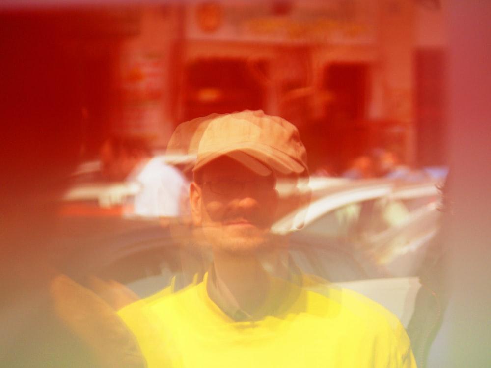 man wearing yellow cap and T-shirt