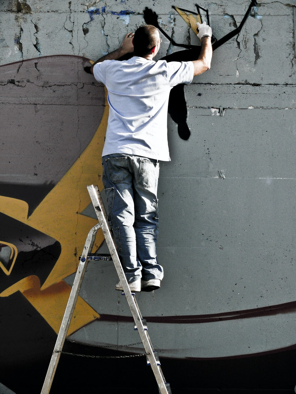 person doing mural paintings