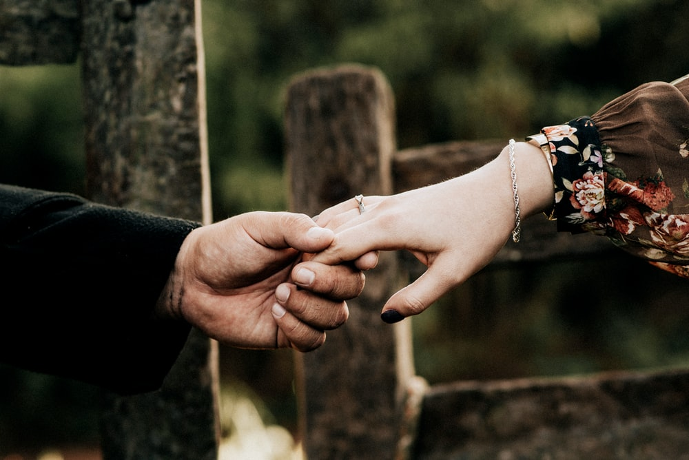 man held woman's hand