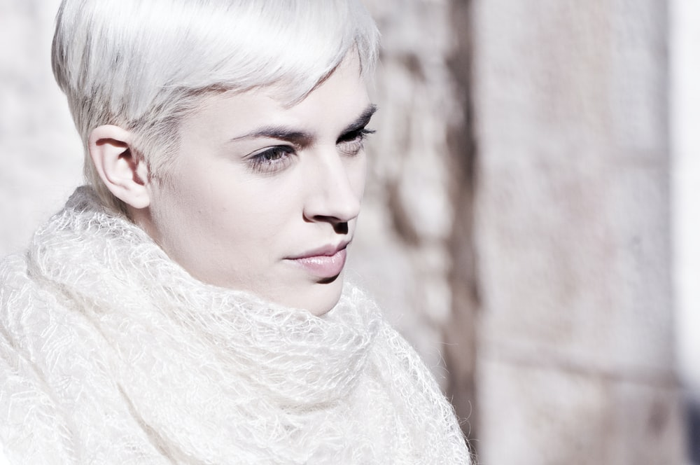 woman with white hair and wearing neckscarf