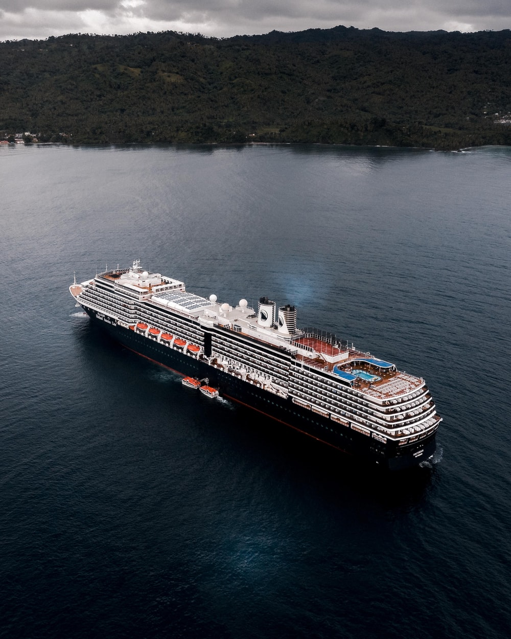 cruise ship on calm body of water