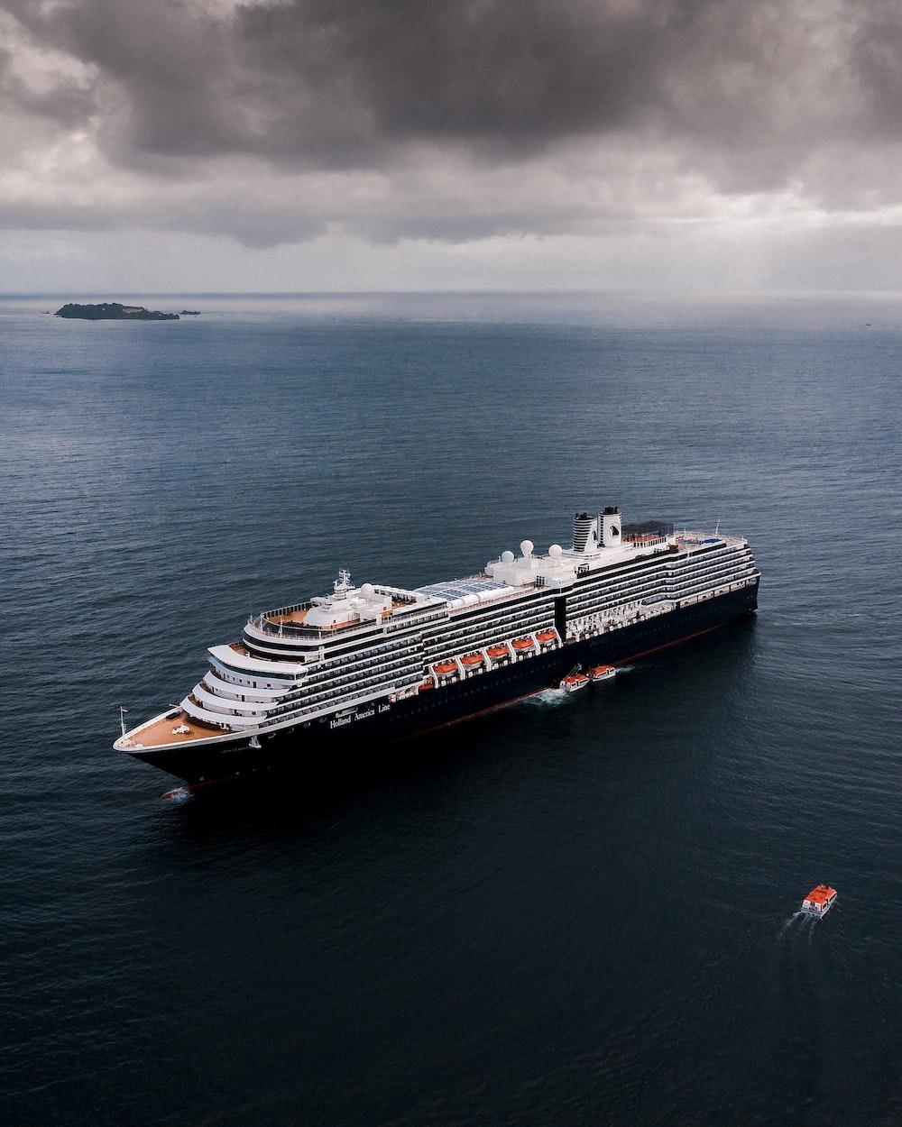 black and white cruise ship sailing on sea