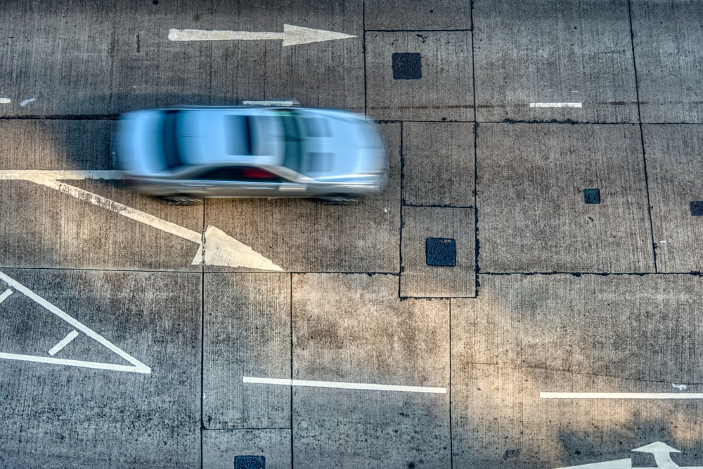 time lapse photography of grey car on road during daytime