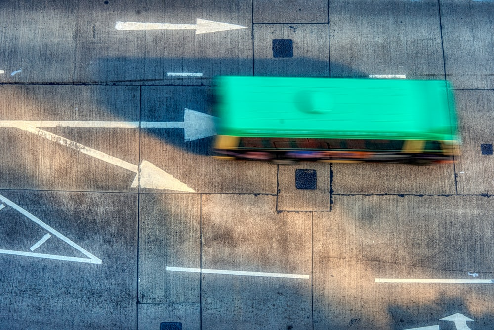 aerial photo of green bus during daytime