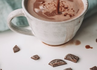 chocolate coffee pouring in white mug