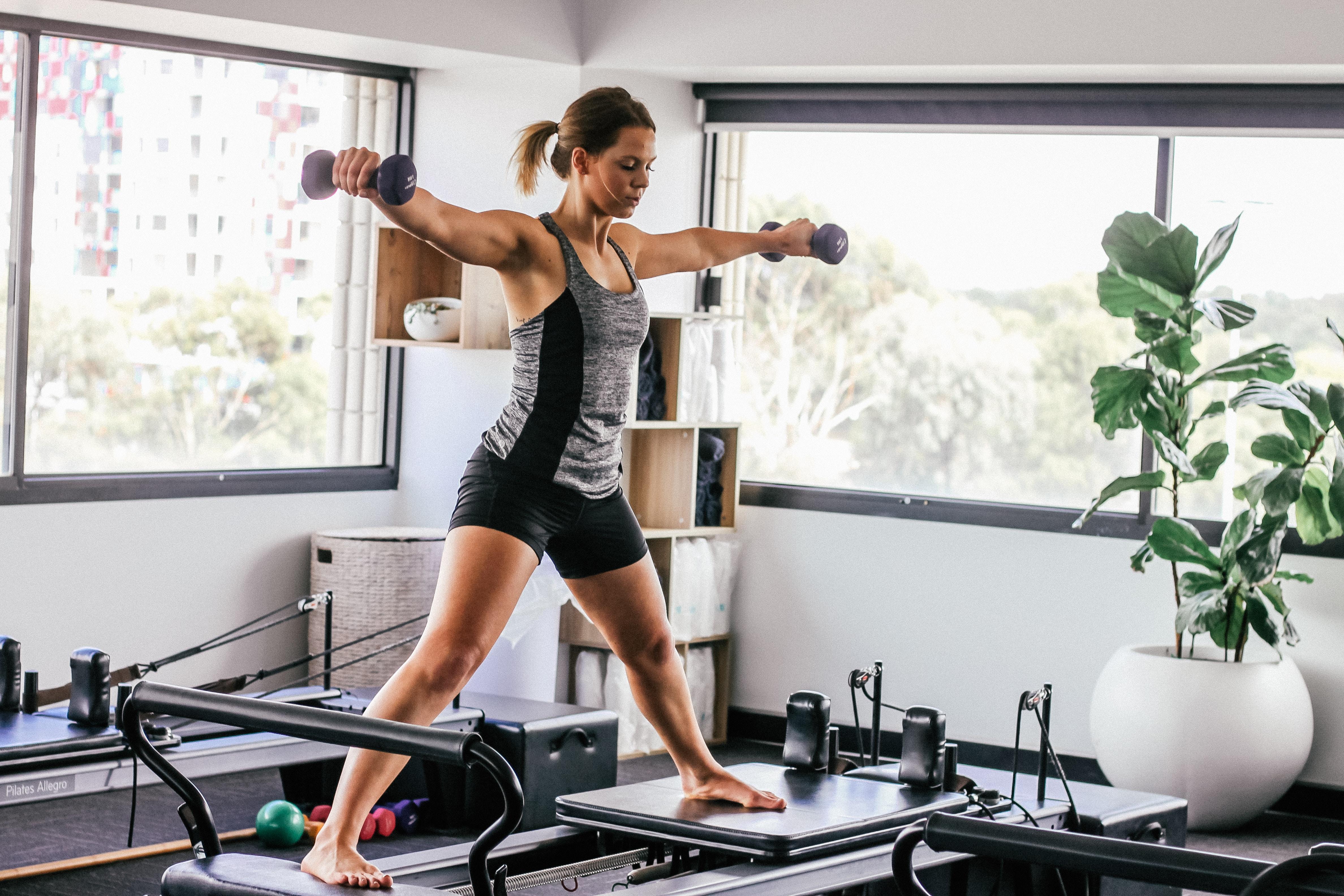 woman doing exercise inside white room